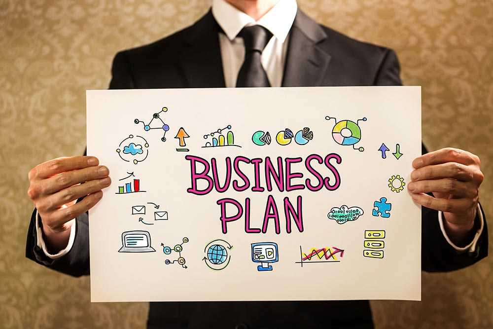Business Plan text with businessman holding a sign board